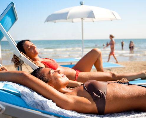 """two young women relaxing at the beach in Rimini, ItalyOTHER BEACH SCENES FROM ITALY:"""