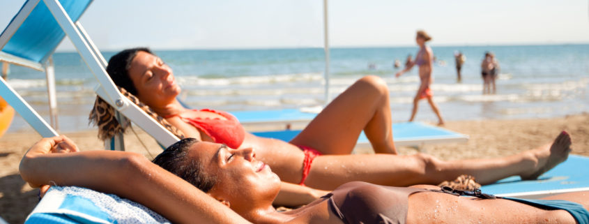 """""""two young women relaxing at the beach in Rimini, ItalyOTHER BEACH SCENES FROM ITALY:"""""""